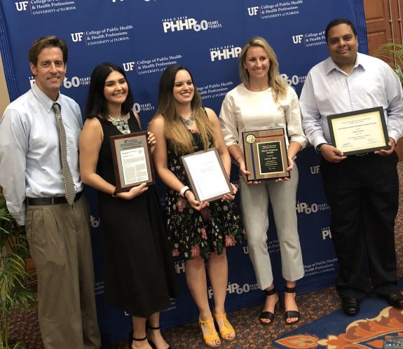 """Pictured from left - Doctor David Fuller, Shabnam Medhizadah and Caitlin Banks won the Rehabilitation Science """"Outstanding Paper"""" Award, Lauren Tabor won the """"Dean's Scholar Award,"""" and Shakeel Ahmed won the """"Frederick Family Scholarship"""" at the 2018 convocation."""