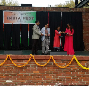picture of Kanika Bansal receiving an award at India Fest