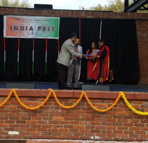 Picture of Kavya Kamalamma receiving a travel award at India Fest