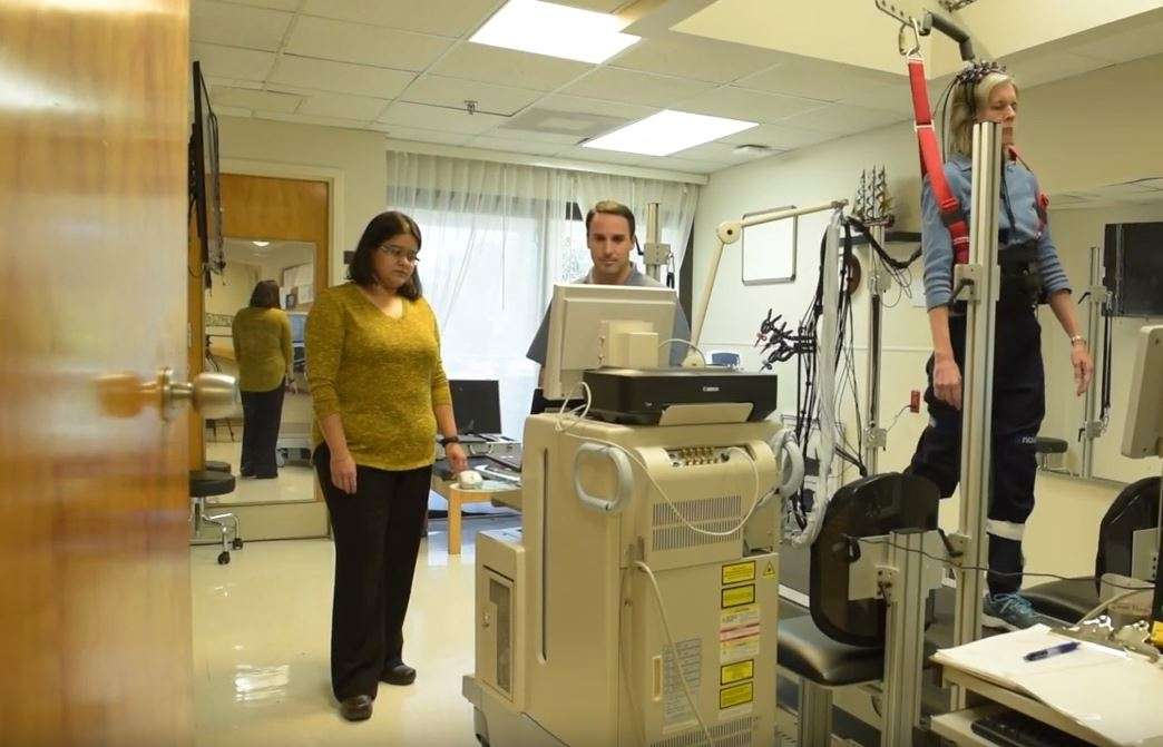 Drs. Sudeshna Chatterjee and David Clark using functional near-infrared spectroscopy to record cortical brain activity.