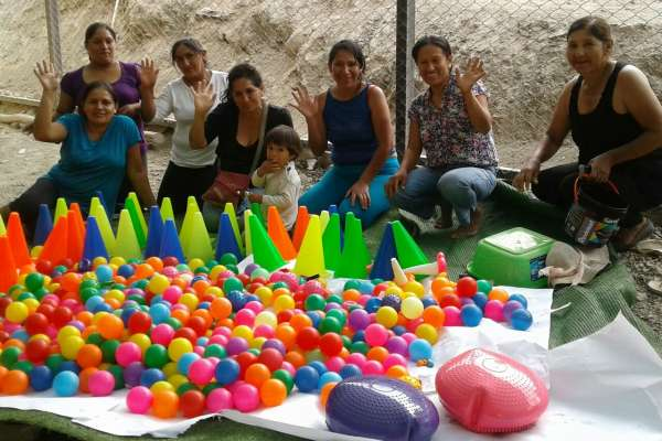 Warmakuna Hope families and volunteers cleaning the equipment and toys for exercises